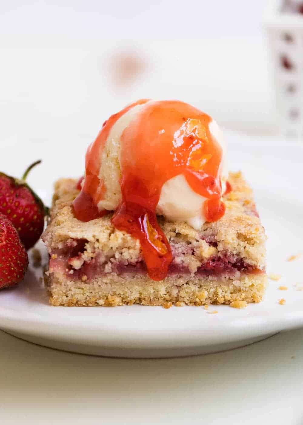 strawberry bars with ice cream and strawberry jam on top