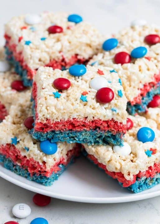 4th of july rice krispie treats stacked on a white plate