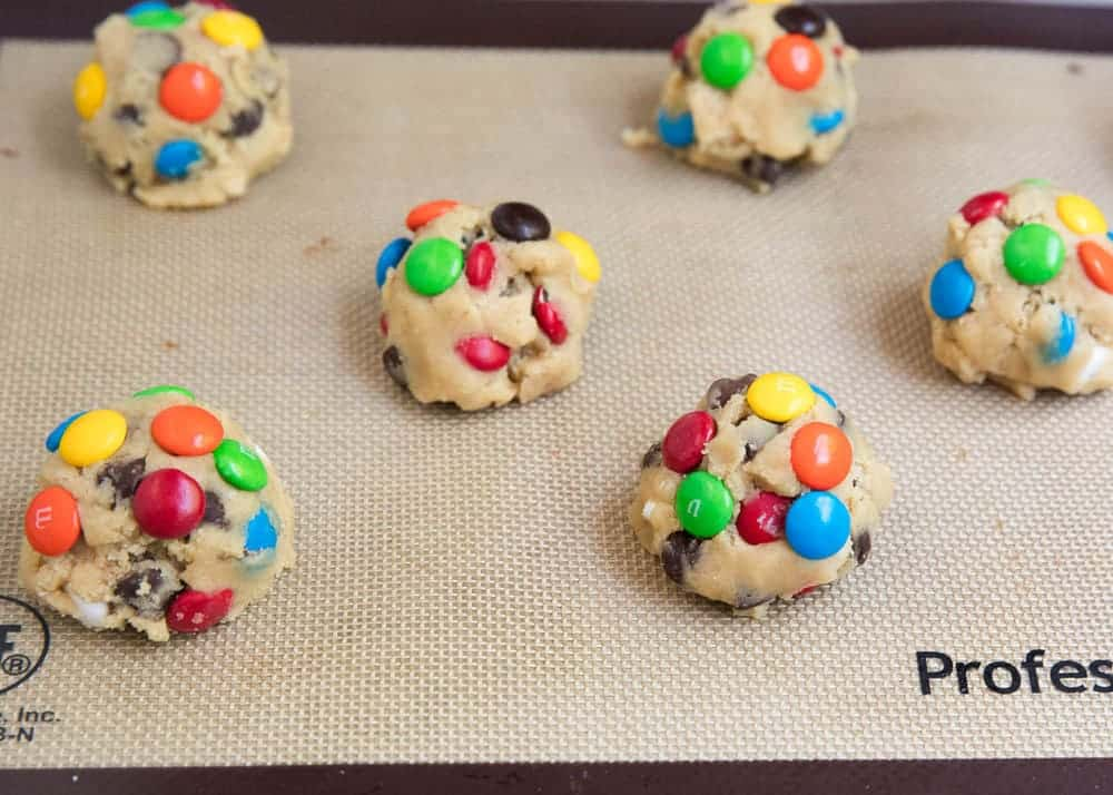 M&M cookie dough balls on baking sheet