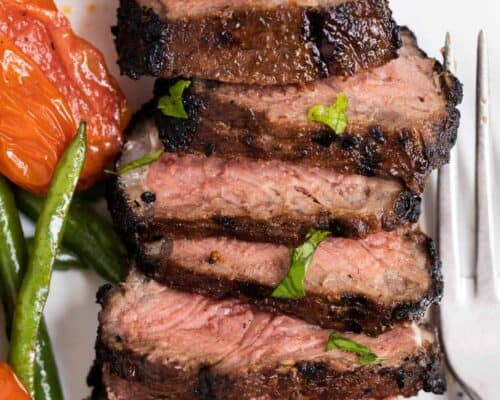 sliced grilled steak on a plate