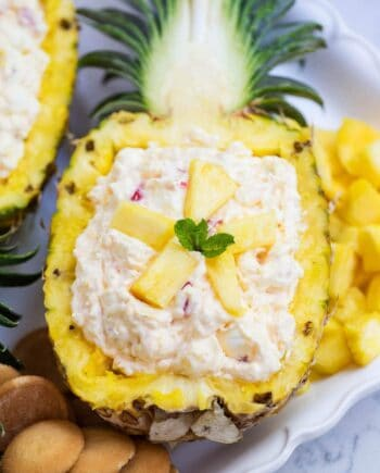 pineapple fluff served in a fresh pineapple boat