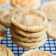 stack of snickerdoodles on a cooling rack