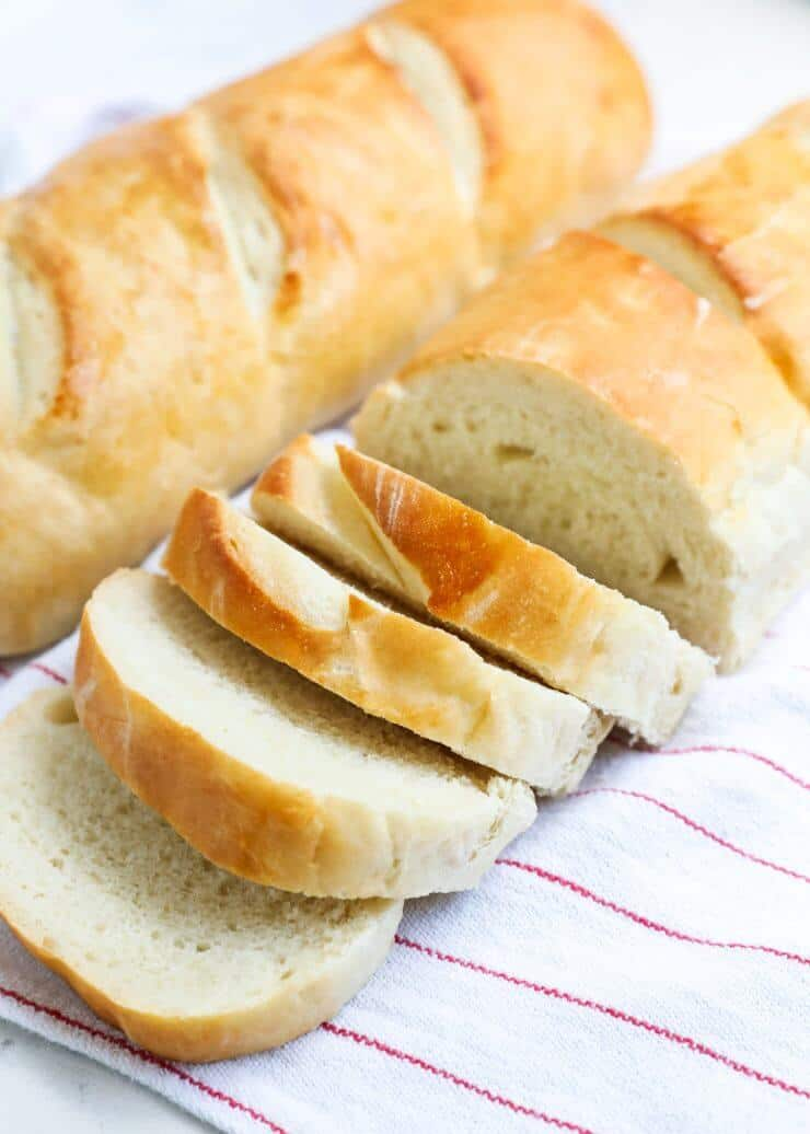 The BEST homemade french bread recipe made in 90 minutes. So easy to make and comes out golden and crispy on the outside, while remaining soft and chewy on the inside.
