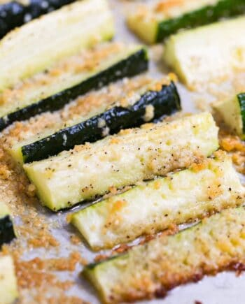 A close up of baked parmesan zucchini fries