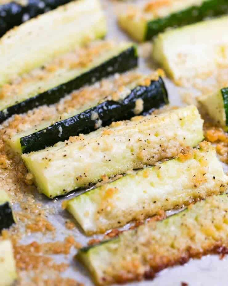 These baked zucchini fries are loaded with flavor and a crispy parmesan topping. They make the perfect side dish for any meal.