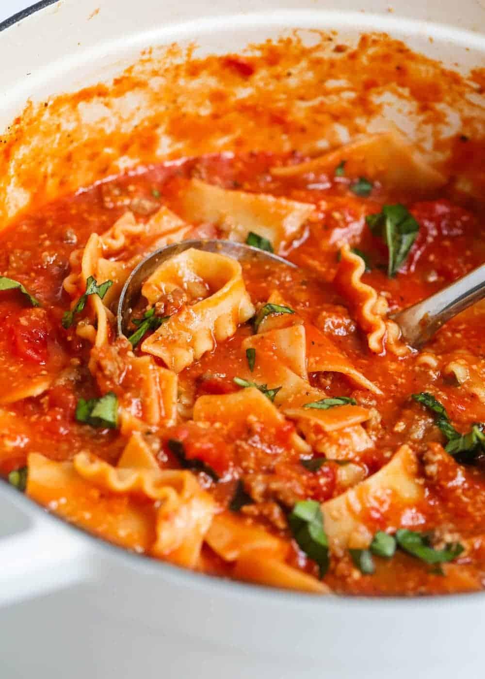 one pot lasagna soup with silver ladle