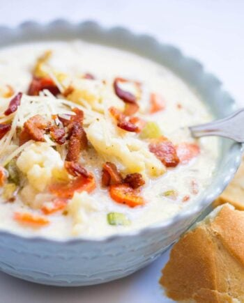 A close up of a bowl of roasted cauliflower soup