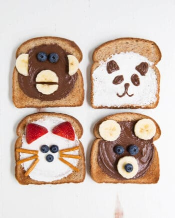 4 pieces of toast decorated to look like animal faces