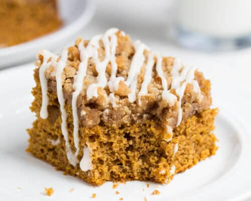 A piece of pumpkin coffee cake on a white plate