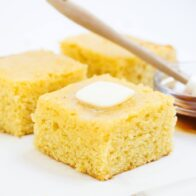slice of sweet cornbread with butter and honey