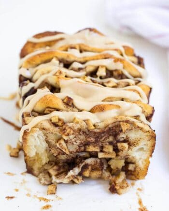loaf of apple pull apart bread drizzled with caramel icing