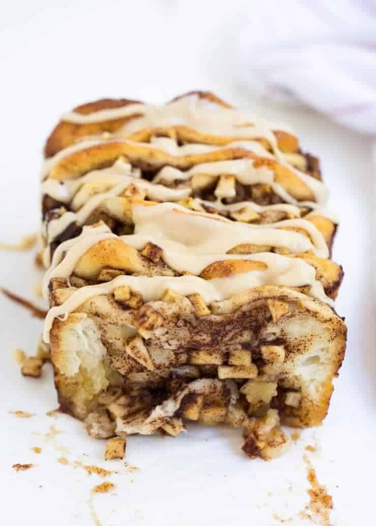 Apple pull apart bread -filled with brown sugared cinnamon apples and topped with the most amazing caramel icing. The perfect fall dessert!