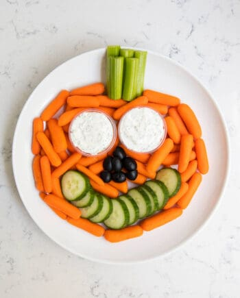 plate of veggies and dip in the shape of a pumpkin