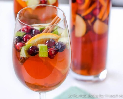 A glass of sangria with fresh fruit