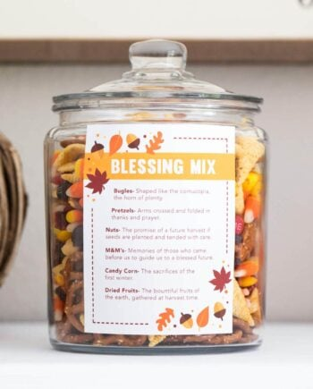 thanksgiving blessing mix in a glass container with a label