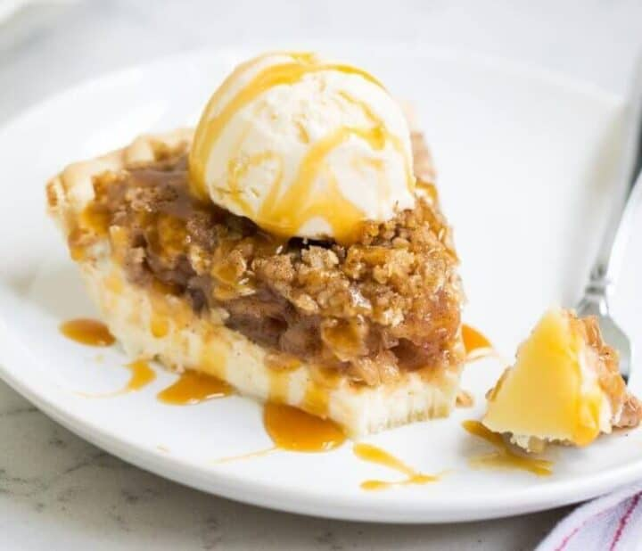 piece of apple cheesecake pie on plate with fork