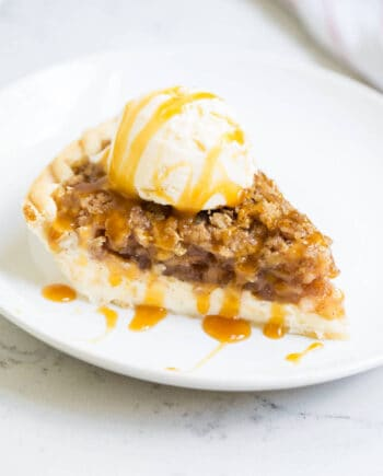 a piece of apple pie cheesecake on a white plate
