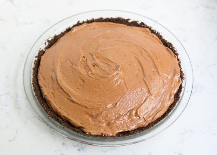 spreading filling over Oreo pie crust