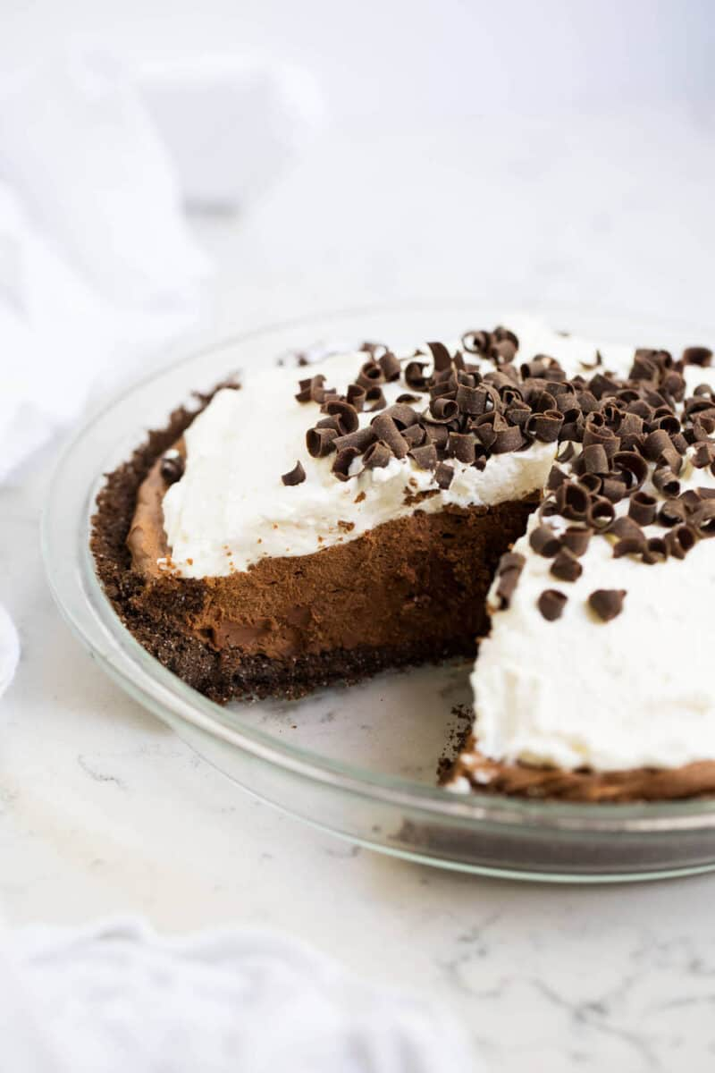 chocolate silk pie in pan with slice taken out