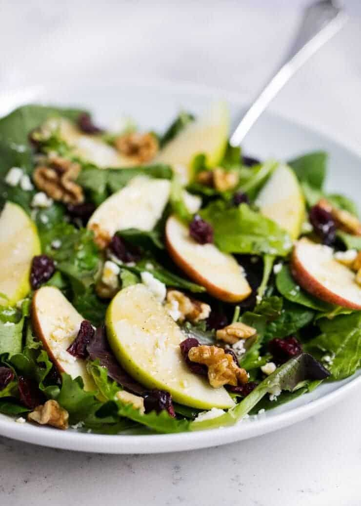 My favorite Christmas salad - made with spinach, apple, cranberry, walnut, feta and a honey dijon dressing.