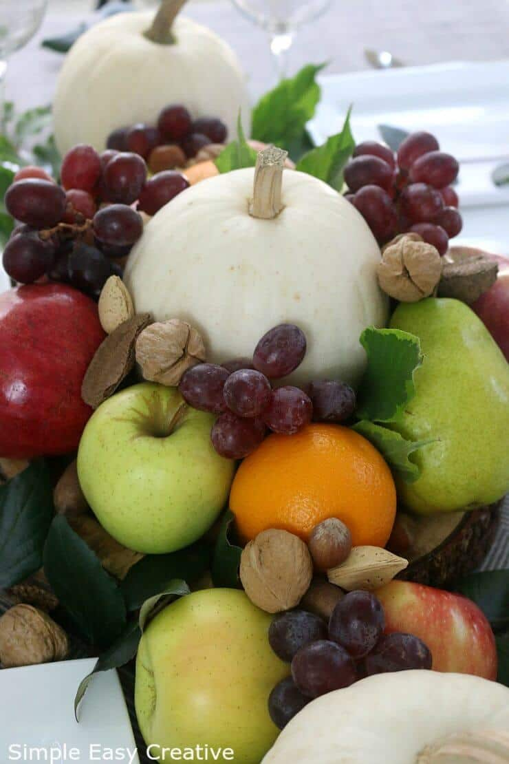 Creating a gorgeous holiday centerpiece for your table doesn't need to cost a lot of money or take a lot of time. I love using fresh ingredients like fruit and nuts that can be eaten later.