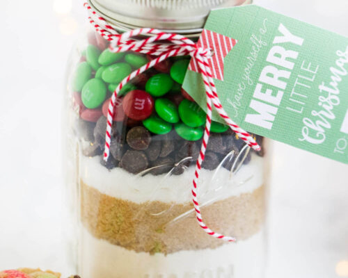 M&M cookie mix layered in a mason jar with a christmas tag