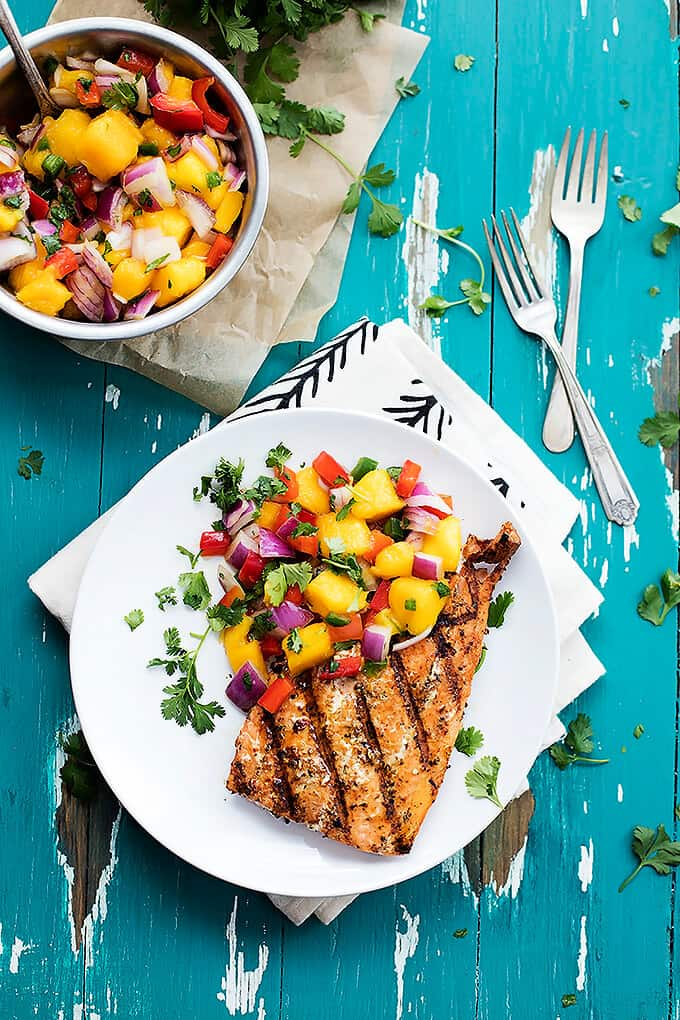 grilled salmon with mango salsa on white plate