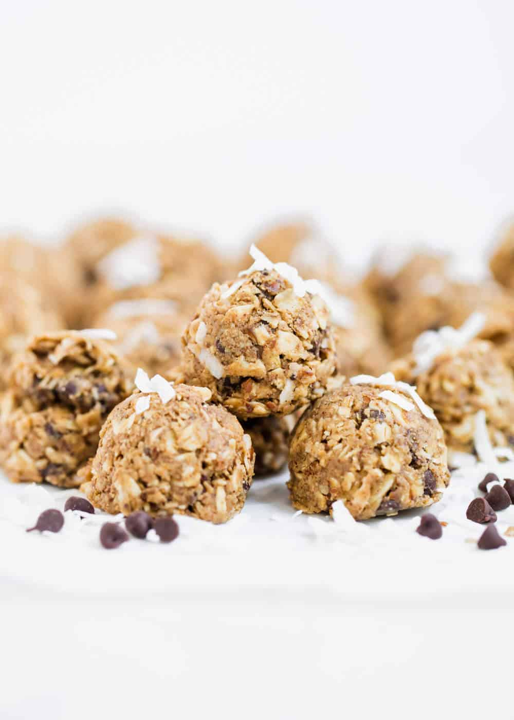 almond joy energy bites topped with shredded coconut and chocolate chips