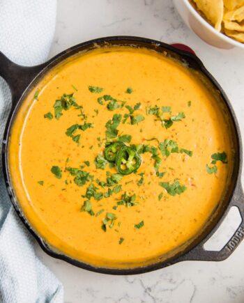 chorizo queso in a cast iron skillet