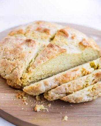 irish soda bread on a cutting board cut into slices
