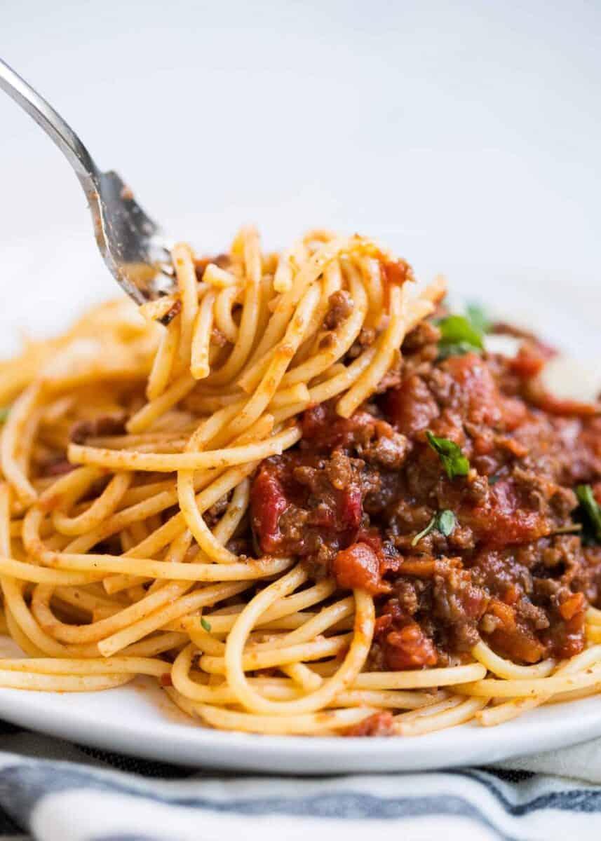twisting spaghetti bolognese on fork