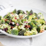 broccoli bacon salad in a shallow white bowl