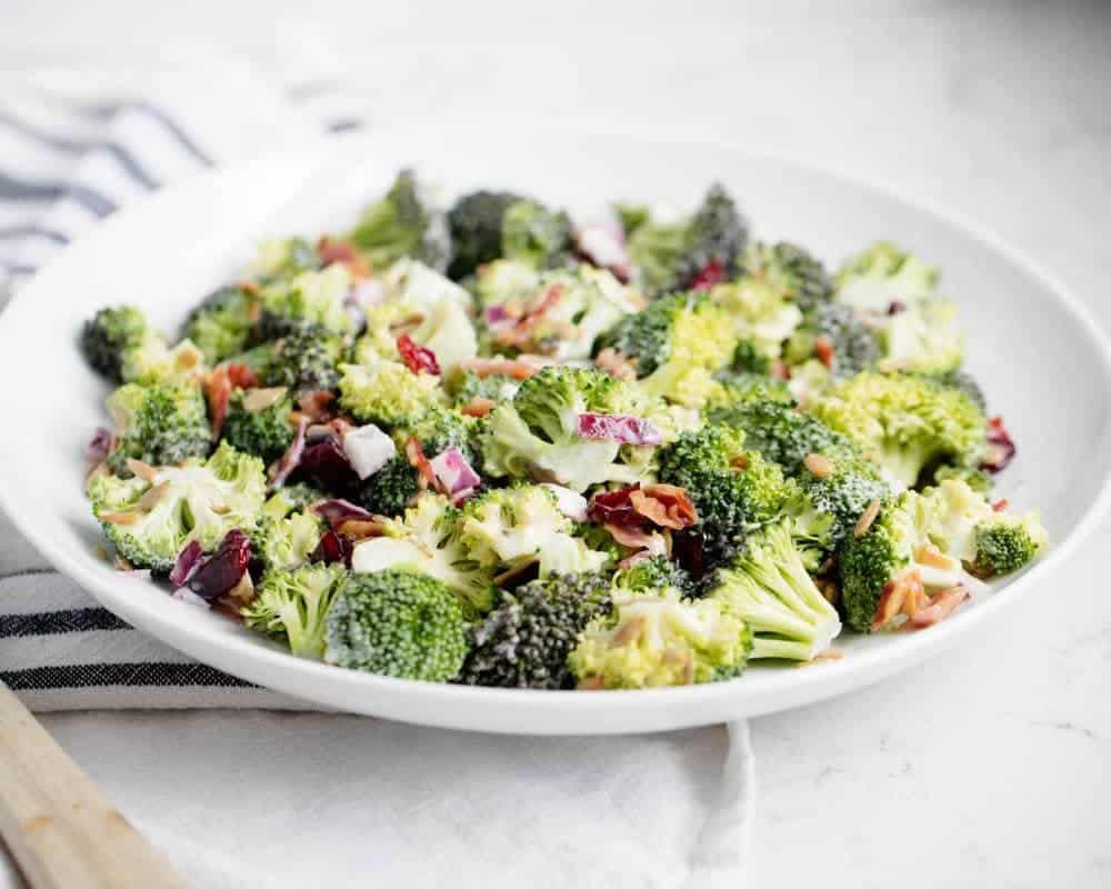 broccoli salad with bacon on a large white plate