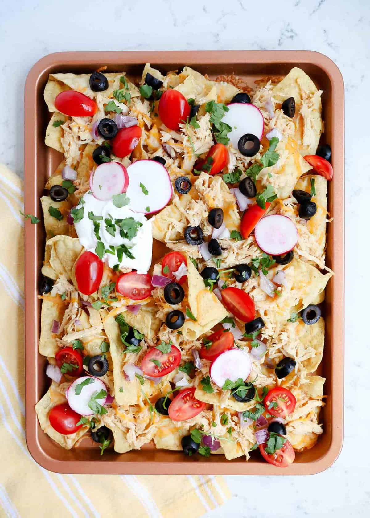 Sheet pan nachos with shredded chicken