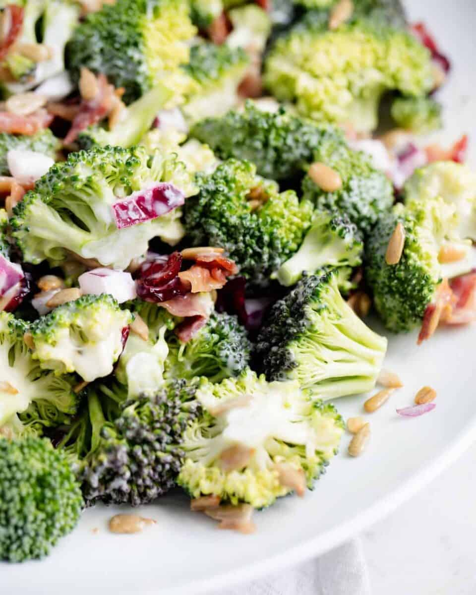 close up of broccoli bacon salad on white plate
