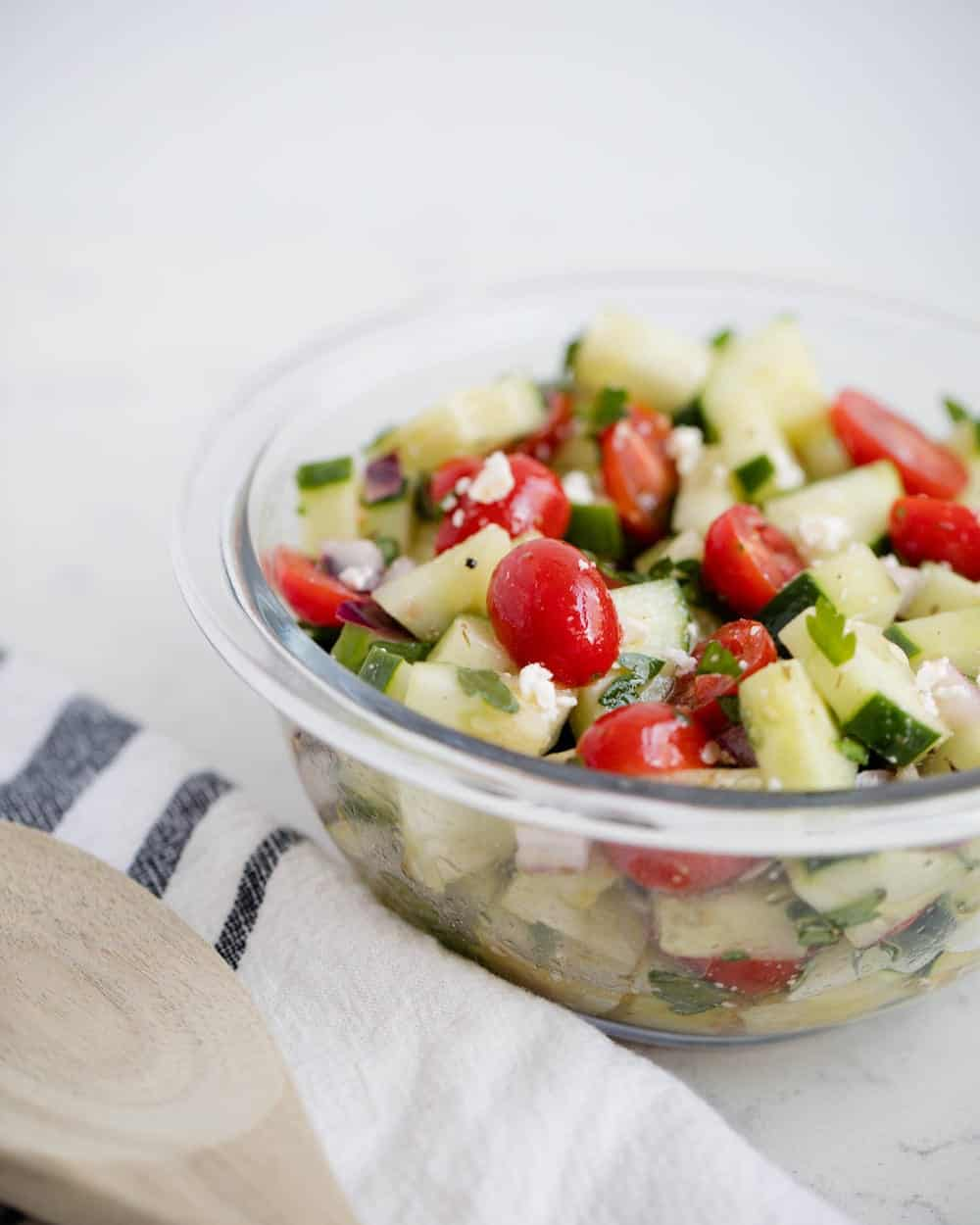 Cucumber salad recipe in a glass bowl