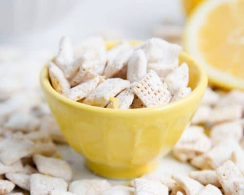 lemon muddy buddies in a yellow bowl