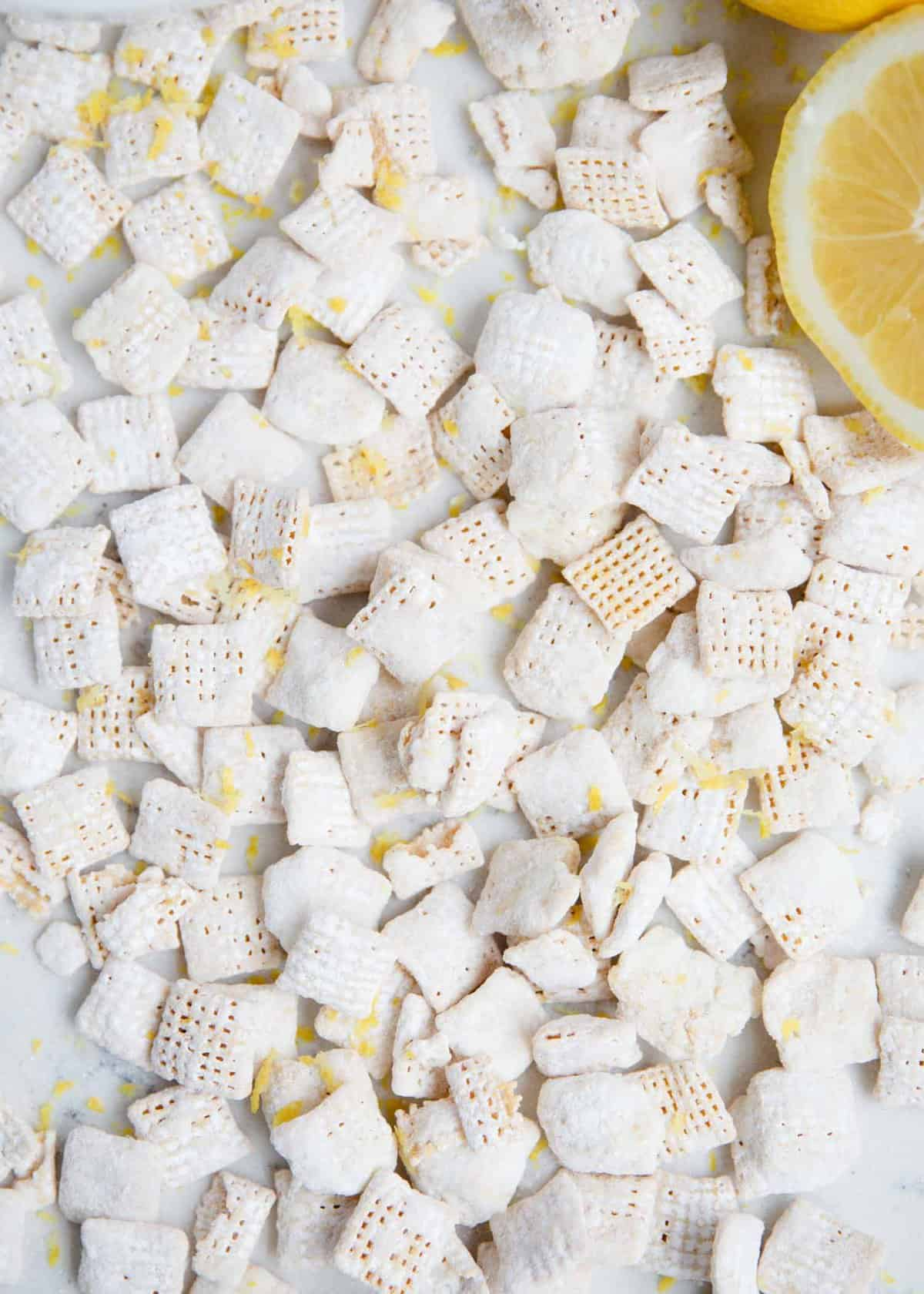 lemon muddy buddies with fresh lemon zest on top