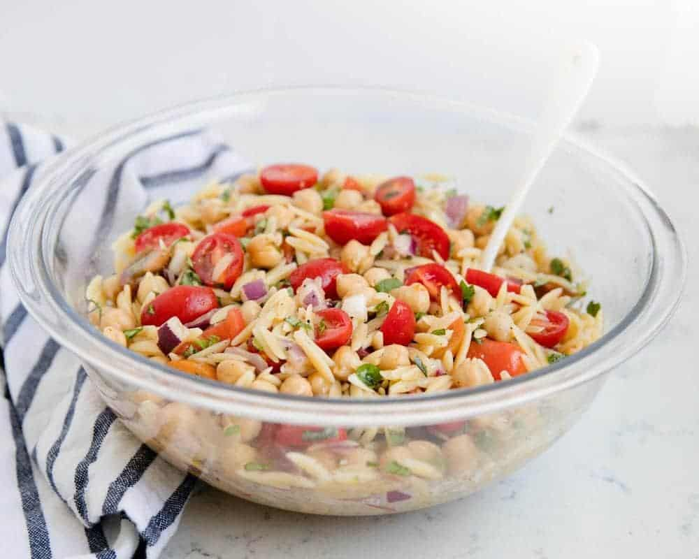 orzo pasta salad in a glass bowl