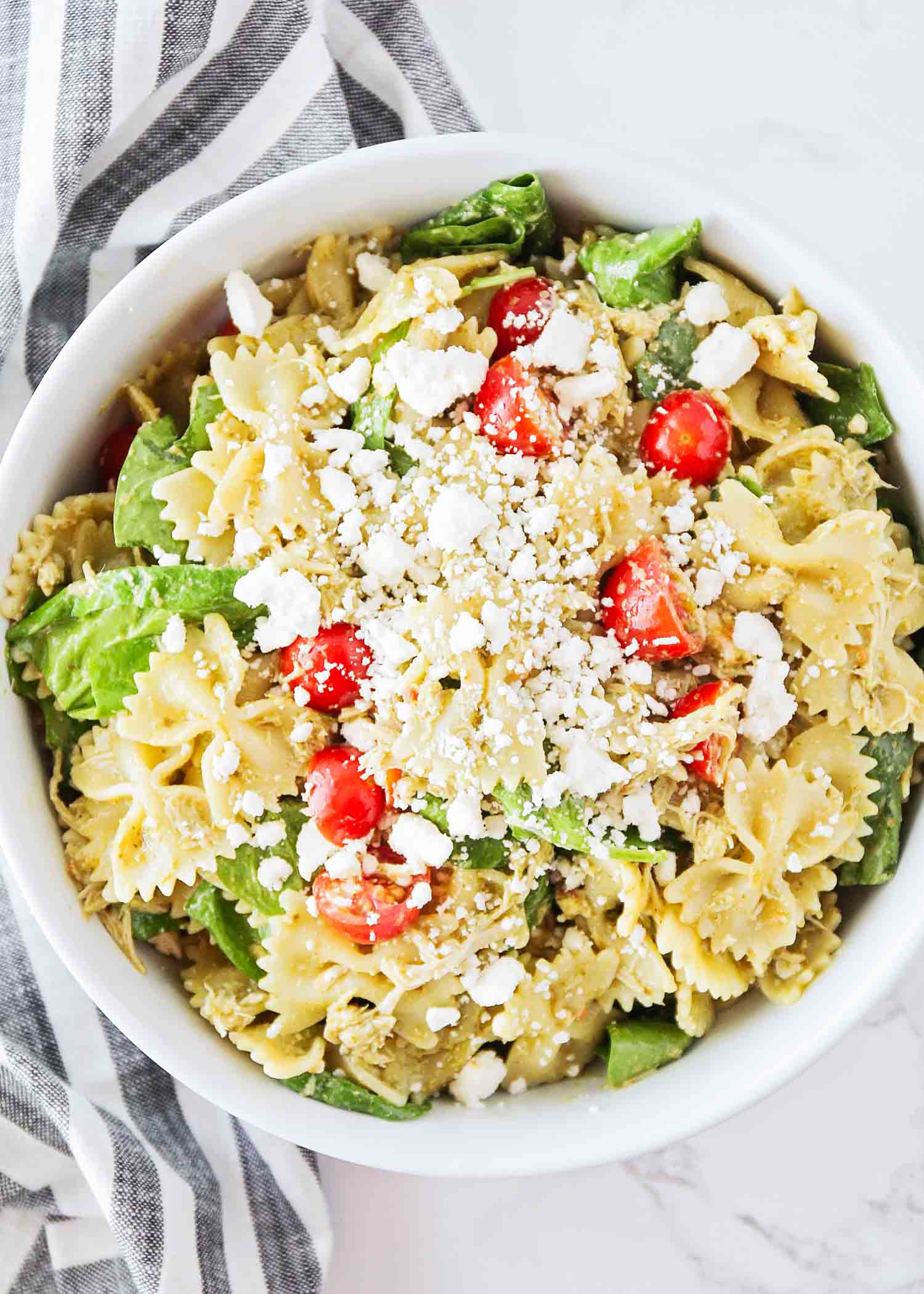 pesto chicken pasta salad in a large bowl