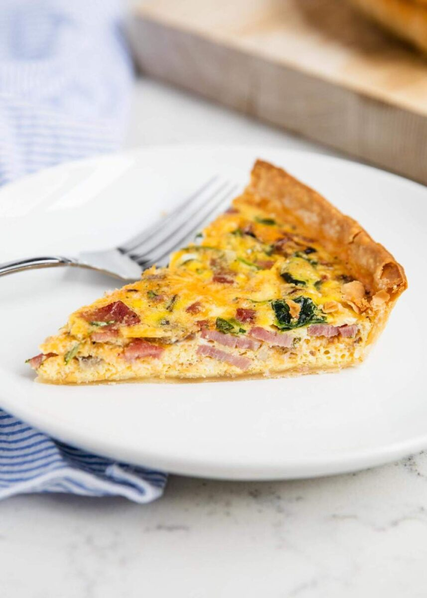 slice of ham quiche on a white plate