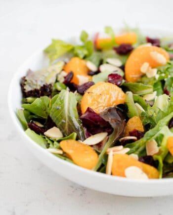 mandarin orange salad in a white bowl