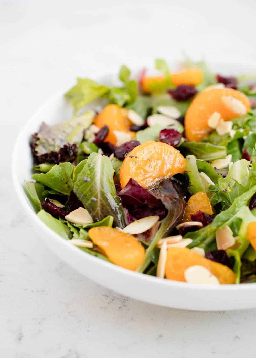 mandarin orange salad in a white bowl