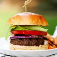 a close up of a hamburger on a plate