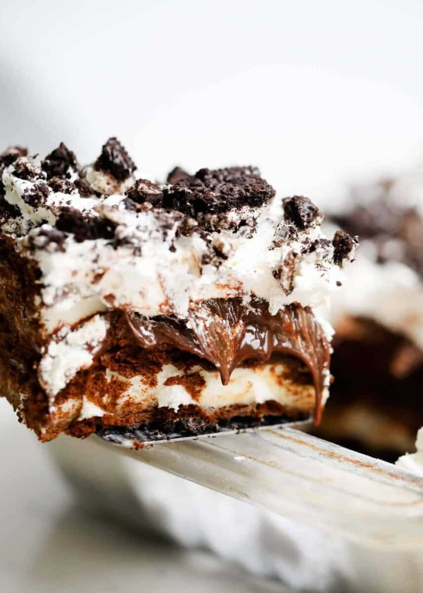 piece of Oreo ice cream cake with hot fudge oozing out