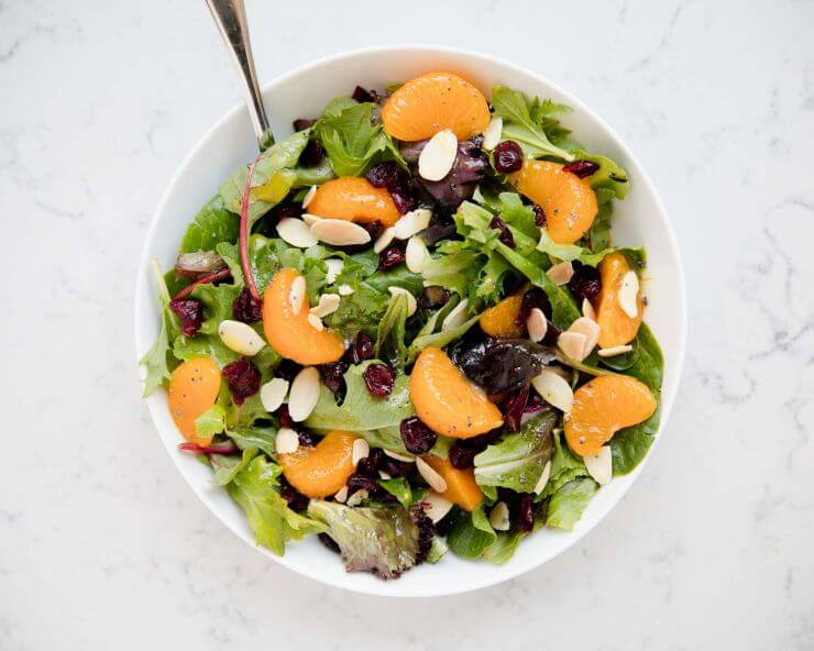 mandarin orange salad in a large white bowl