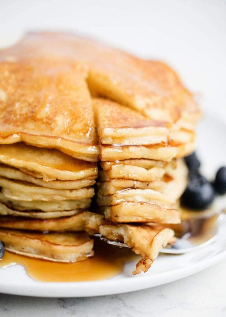 stack of ricotta pancakes with maple syrup