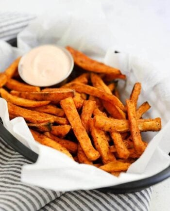 sweet potato fries in a basket with fry sauce