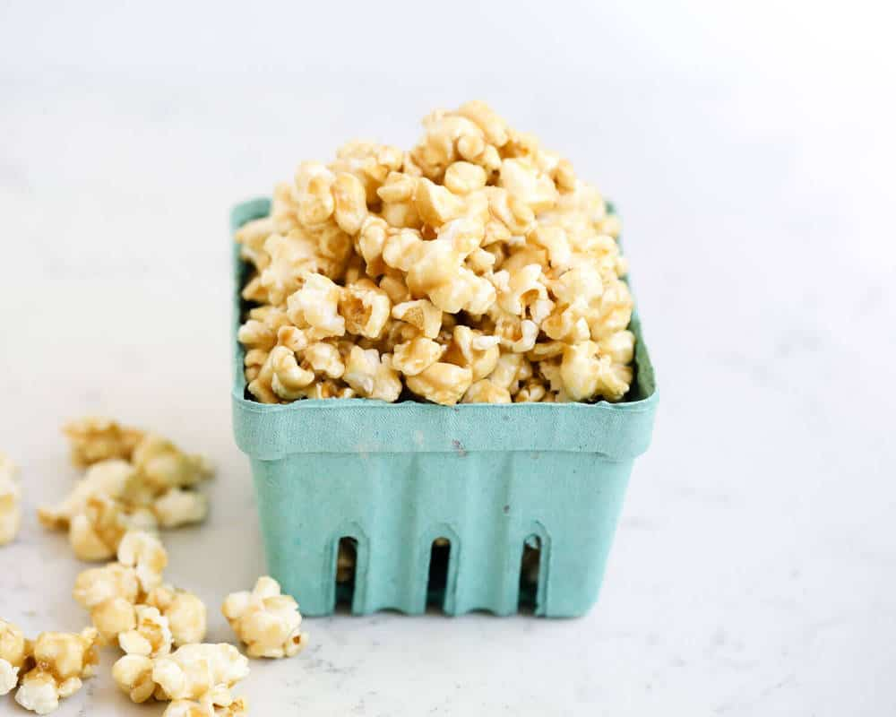 caramel corn in a blue carton