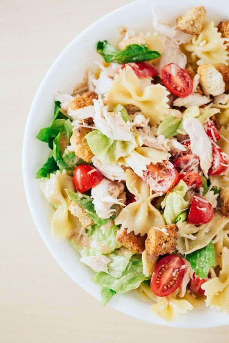 chicken caesar pasta salad in white bowl